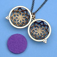 Spiral Star Aromatherapy Locket - Bronze Tone